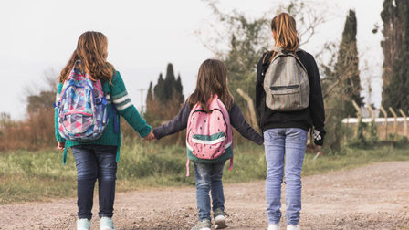 Anonymous-kids-walking-school_23-2147863683_thumb_main